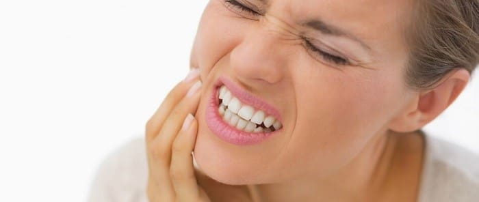 درمان عفونت دندان روکش شده با دارو و عصب کشی مجدد